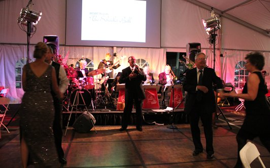 After dinner and the live auction, HATSOFF! guests swing to our big band to end a great evening.